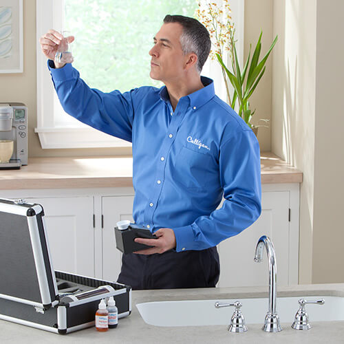 Culligan expert using well water test kit
