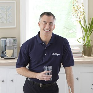 culligan water expert with glass of water