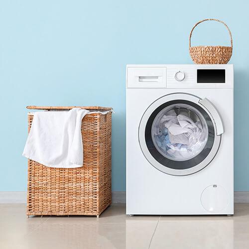 washing machine against blue background