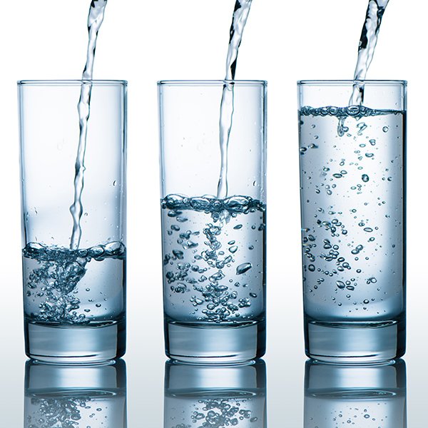 three glasses of water filling up