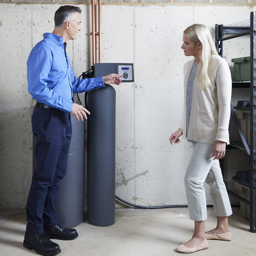 Culligan employee installing a water softener for a customer